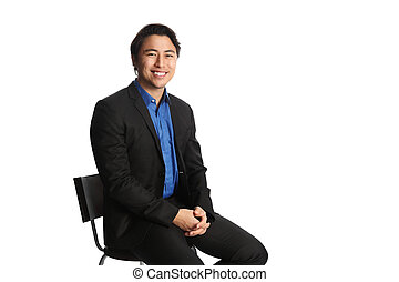 Businessman in a suit sitting down - Man in his 20s sitting...