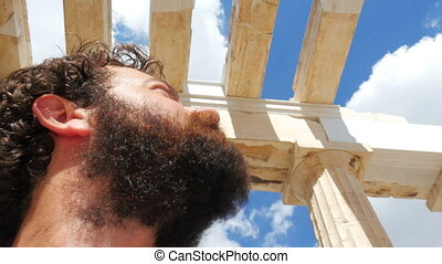 quot;tourist man walking through ancient acropolis temple...