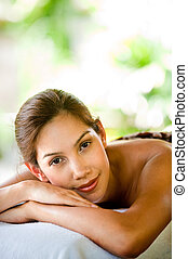 Woman At Spa - An attractive young woman lying on a massage...