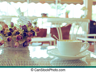 hot coffee drink caramel macchiato, white cup on table
