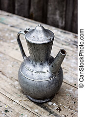 Old metal pitcher vintage items - Old metal pitcher on a...