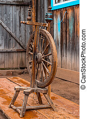 Old spinning wheel. vintage - Old spinning wheel in the...