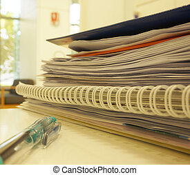 stack of documents in office desk