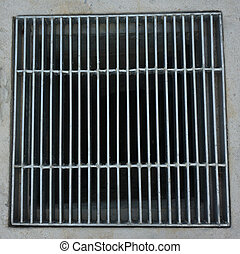 Sewer grate on roadside - Sewer grate made of steel...