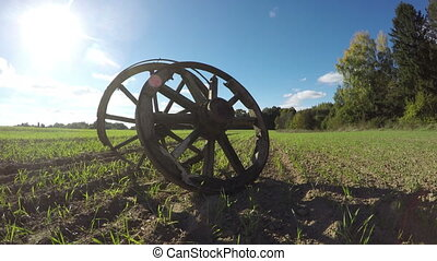 Landscape with two wooden wheels