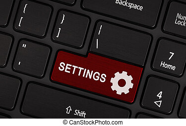 Red button Settings on black laptop keyboard