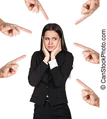 Many hands points on business woman isolated over white...