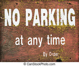 No Parking Sign - A grungy, weathered wooden No Parking sign...
