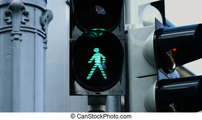 Close-up picture of the traffic light during the day when...
