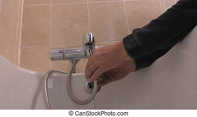 Plumber connecting shower hose - Professional plumber...