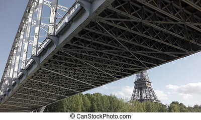 Sliding camera over Seine river with Eiffel Tower - Under...