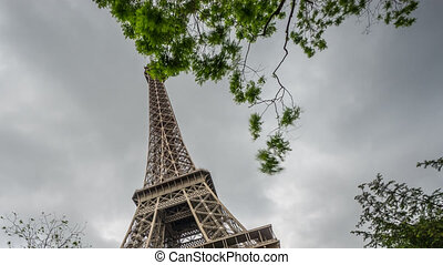 The Eiffel Tower in Paris time lapse, high section - High...