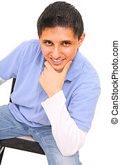 Teen Posing Sit Down - sitting teenager holding his chin and...