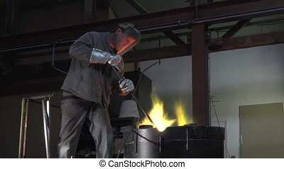 Lost wax bronze casting - handling elements during melting