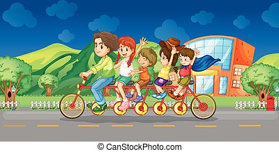 Family riding on bicycle at night