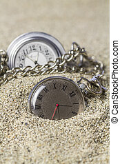 Lying on the sand pocket watch - Pocket watch with its Roman...