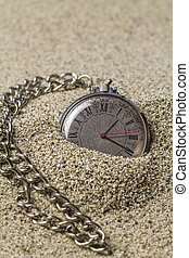 Clock with chain on sand - Pocket watch with a chain on the...