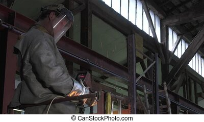 Lost wax bronze casting - taking the molten metal...
