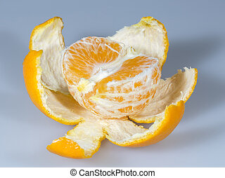 Half Clementine with Peal close up on grey background