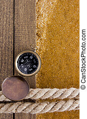 Berth rope on a wooden background at the waters edge and...