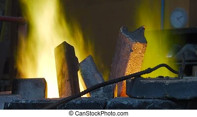 Lost wax bronze casting - being cast ingots in the crucible