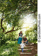 Happy Family Spending Time Together Outdoors Pregnant Woman,...