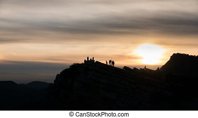 Sunset at top of the mountain - Tourist enjoying sunset at...