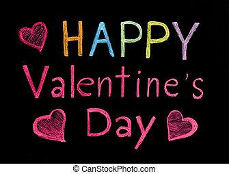 Happy Valentine's day written on blackboard