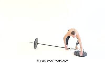Muscular Man Prepares and Lifts Weights - Muscular Man...
