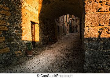 old wooden door in the narrow streets of Cefalu