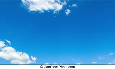 Clouds moving in the blue sky. - White clouds moving across...