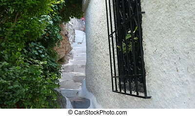 """single man walking narrow streets of plaka, athens, greece,..."
