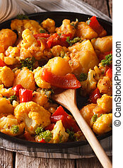 Indian cuisine: Gobi Aloo close-up on a plate. Vertical -...