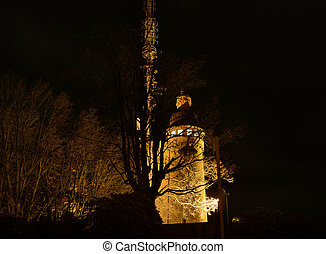 Old meteo tower illuminated at night - Evening view with...