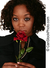 African American Girl Smelling Rose - head shot of african...