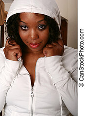 African American Girl In White Hood - close up shot of...