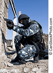 Soldier with a semi-automatic glock pistol - Armed officer...