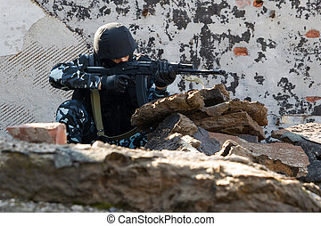 Soldier targeting with an AK-47 automatic rifle - Soldier...