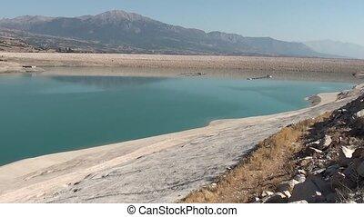 Barrage blue lake panning - Blue barrage lake daytime,...