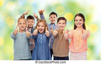 happy children showing thumbs up - childhood, fashion,...