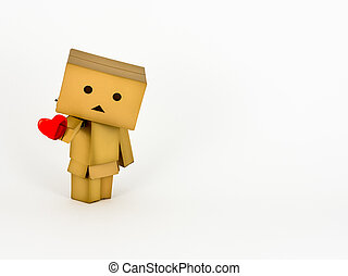 Danbo holding a heart - Cute Danbo character lovingly holds...
