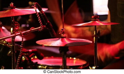 Man playing drums at concert