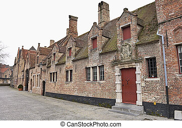 Old Flemish houses and cobblestones street in Brugge,...