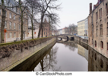 Old Flemish houses and canal street in Brugge, Belgium
