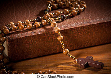 closed book with rosary