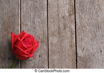 Valentine s day background with rose on wooden