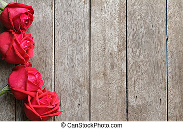 Valentine s day background with roses on wooden