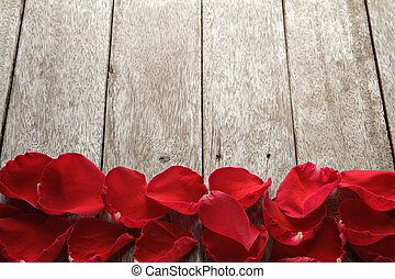 Valentine s day background with petals of rose on wooden