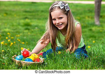Child find easter egg outdoor - Happy beautiful child find...