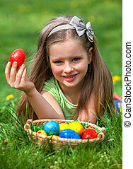 Child find easter egg outdoor - Happy child finds easter...